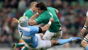 'Shrugging off' hardly does it justice. Mike McCarthy throws Pumas openside Juan Leguizamon away in the recent November international between Ireland and Argentina.