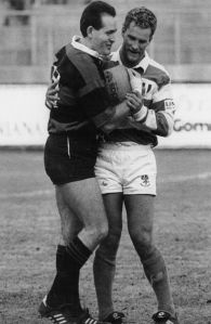 Michael Lynagh and David Campese share a joke in October 1992 during a Super 10 game between Amatori Milano and Benetton Treviso.
