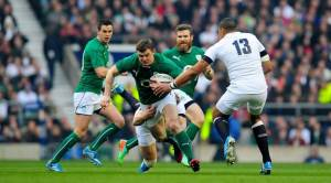 Brian O'Driscoll slips out of Billy Twelvetrees' tackle in his first carry of the game. The former Irish captain turned in his best attacking performance of the Six Nations and showcased his wide array of skills.